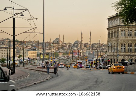 ISTANBUL, TURKEY - JUNE 04: Galata Bridge across the Golden Horn. View from Galata district at the road to Yeni Cami on June 04, 2012 in Istanbul, Turkey. Galata Bridge is a link between two districts
