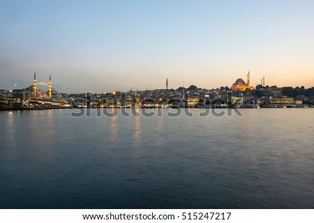 ISTANBUL, TURKEY - JUNE 20, 2015: Night view on the Suleymaniye Mosque, New Mosque and fishing boats in Eminonu, Istanbul, Turkey #515247217