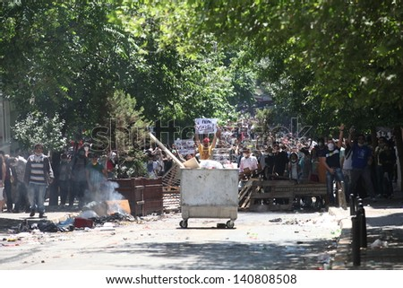 ISTANBUL,TURKEY-JUNE 1: Protesters in Taksim continue as minor scuffles break out and protesters lob fireworks at officers. Police removed barricades around the square on June 1,2013 in Istanbul.