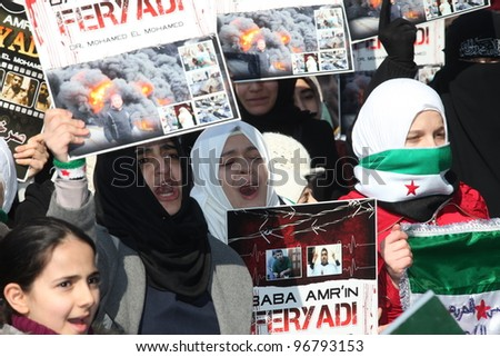 ISTANBUL, TURKEY-MARCH 2: A group of unidentified people stage a demonstration in front of the Beyazit Mosque, protesting Syrian authorities' violent crackdown in Homs, on March 2, 2012 in Istanbul,Turkey