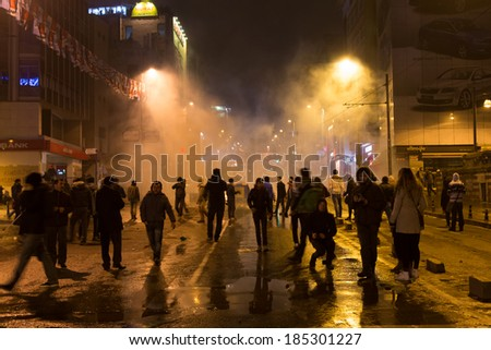ISTANBUL, TURKEY - MARCH 11, 2014: People gathered in Kadikoy to protest after Berkin Elvan, who was 15 years old, died. He was hit in the head with a tear gas canister by Police. - Shutterstock ID 185301227