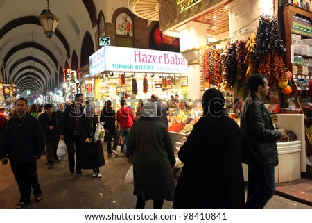 ISTANBUL,TURKEY - MARCH 21: Tourists visiting Egyptian Bazaar (Spice Bazaar) on March 21, 2012 in Istanbul, Turkey. Located in Emin�¶n�¼ is the second largest covered shopping complex after Grand Bazaar - stock photo