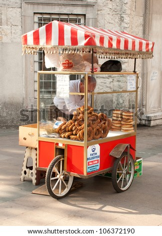 "ISTANBUL, TURKEY - MAY 30: An old man sells traditional baked pasteries called ""Simit"" in the Sultanahmet area of Istanbul, Turkey on May 30, 2012."