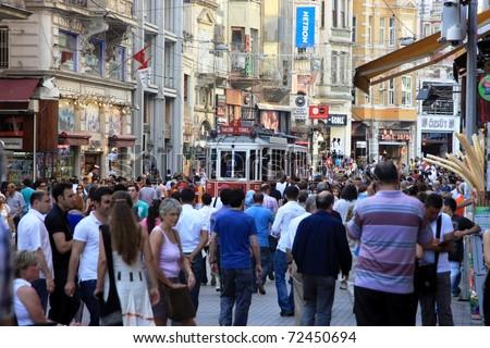 ISTANBUL, TURKEY - MAY 14 : Taksim Istiklal Street at eventide on May 14, 2010 in Istanbul, Turkey. Taksim Istiklal Street is a popular destination in Istanbul.