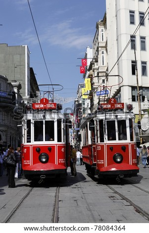 ISTANBUL, TURKEY - MAY 25 : Two trams sit side by side in Taksim Istiklal Street on May 25, 2011 in Istanbul, Turkey. Taksim Istiklal Street is one of the popular destinations in Istanbul.