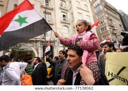 ISTANBUL,TURKEY-MAY 13: Unidentified Syrians living in Istanbul and Civil Society Organizations protest the regime of Bashar Essad in front of Syrian Consulate building on May 13, 2011 in Istanbul, Turkey.