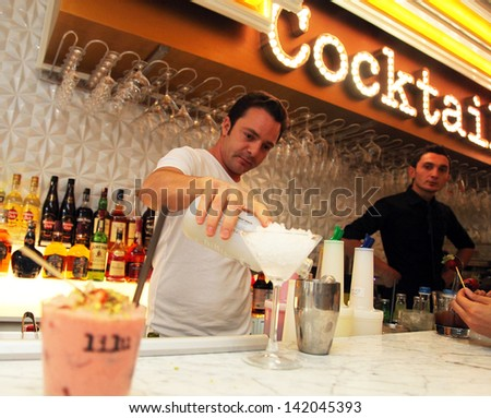 ISTANBUL, TURKEY - OCTOBER 18: Bartender is pouring a drink at the famous cocktail bar Lilu on October 18, 2012 in Istanbul, Turkey.