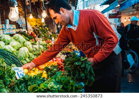 ISTANBUL, TURKEY - October, 26, 2014: Different kinds of fresh vegetables and fruits on sale at street market in Istanbul, Turkey.