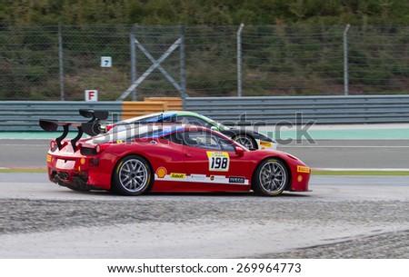 ISTANBUL, TURKEY - OCTOBER 26, 2014: Eric Cheung drives Ferrari 458 Challenge EVO of Motor Piacenza Racing Team during Ferrari Racing Days in Istanbul Park Racing Circuit