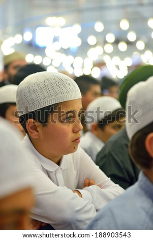 ISTANBUL, TURKEY - OCTOBER 6: Fatih Mosque to pray for the kids on October 6, 2013 in Istanbul. Held in Istanbul Fatih Mosque about 7 thousand children participated in the program.