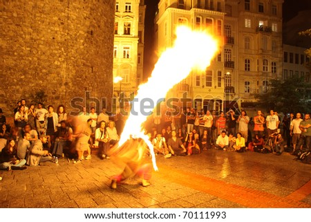 ISTANBUL, TURKEY - SEPTEMBER 05: A street performer blows fire during street shows in Galata square on September 05, 2010 in Istanbul, Turkey