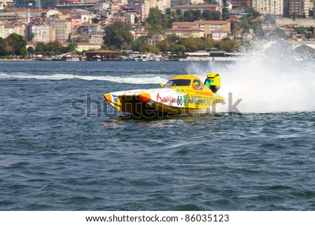 ISTANBUL, TURKEY - SEPTEMBER 17: Baris KESME and Suha YENIGUL drive Angel Yacht Offshore 225 boat during World Offshore 225 Championship, Halic stage on September 17, 2011 in Istanbul, Turkey