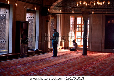 ISTANBUL, TURKEY - SEPTEMBER 14: Muslims praying in the Blue Mosque on September 14, 2013 in Istanbul. Blue Mosque of the most visited by tourists, is one of the most famous architectural structures.