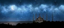 Istanbul, Turkey. Sultan Ahmet Camii named Blue Mosque. Front view of crescent shaped moon and mosque in front of night cloudy and starry sky. ramadan, the holy month of muslims. selective focus