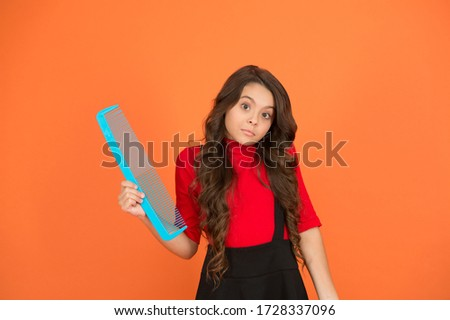 It can be easy to haircare. Small girl hold comb brown background. Haircare tool. Hair untangling. Beauty salon haircare. Haircare and styling routine. Beauty and fashion.