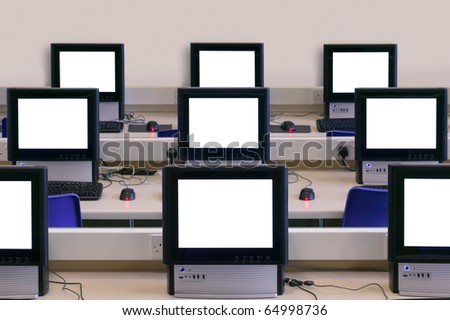 IT classroom with multiple blank computer screens to add your own message or image.