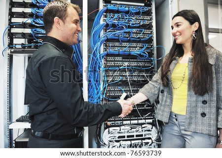 it engineer in network server room solving problems and give help and support #76593739