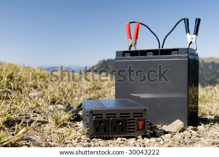 It is a battery and a charger in the outdoor.