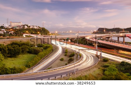 It is a cityscape of interchange with cars light.
