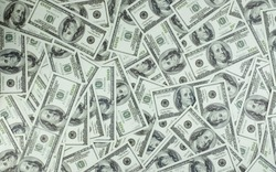 It is a collection of money stacks of 100 US dollar banknotes that make up a large portion of the background, top view