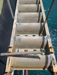 It is a gangway ladder step in cargo ship. The repairing job was done. The blue marking is damaged part before.