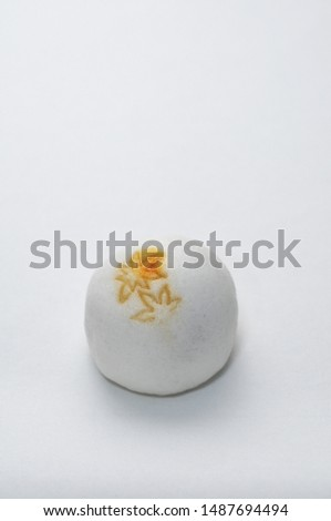 It is a Japanese confectionery with a brand of autumn leaves stamped.