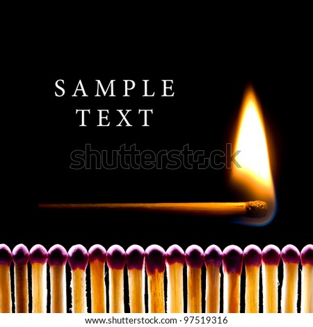It is a lot of matches on a black background. One match burns.