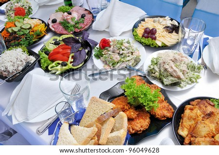 It is a lot of meal on a table - a table it is served for a banquet