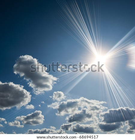 It is a lot of sun rays against clouds and the blue sky