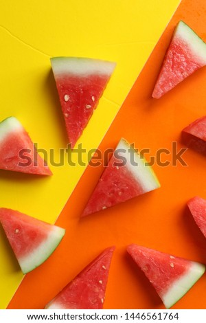 It is a picture of a watermelon cut into a triangle on a yellow-orange background