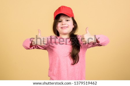 It is a real pleasure. Cute small child gesturing approval sign and feeling pleasure. Adorable little girl showing approval hand gesture with pleasure. Look of pleasure.
