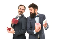 It is bargain. businessmen in formal suit on party. happy birthday shopping. business partners on meeting isolated on white. success and reward. esthete. bearded men hold valentines present. bargain.