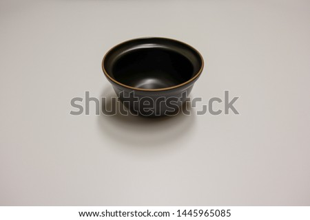 It is black rice bowl, soup bowl.