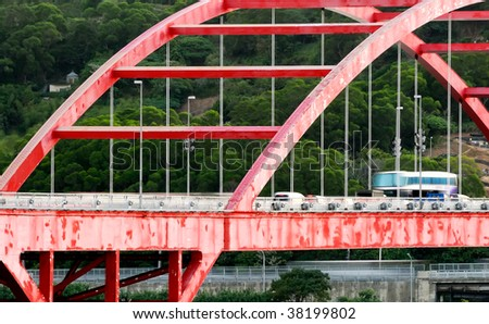It is cityscape of cars in the red bridge.