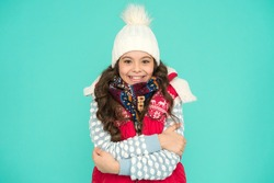 it is cold outside. Feeling warm and happy. winter vibes. Portrait of smiling girl hipster. Youth street fashion. Winter fun. feeling cold this season. Dress in layers and wear hat. Stay active.