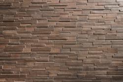 It is Dark  brown brick wall for pattern.