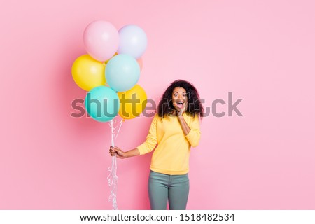 It is for me? Portrait of excited shocked girl hold many balons get gift for anniversary 8-march impressed scream wow omg wear yellow pullover pants isolated over pastel color background