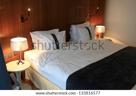 It is interior of hotel room at night