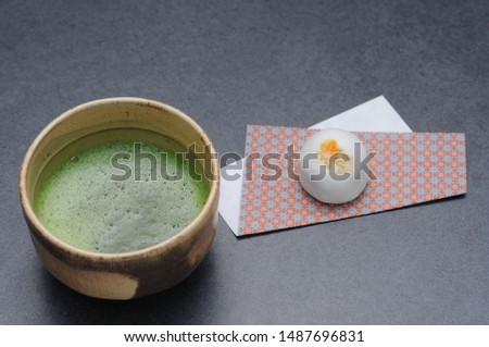It is japanese confectionery and matcha with the brand of autumn leaves stamped.