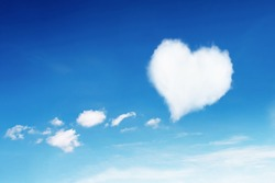 it is lonely white heart shaped cloud on blue sky for pattern.