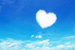 it is one white heart shaped cloud on blue sky.