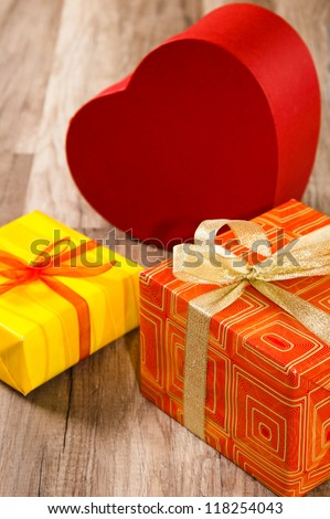 It is red yellow gift boxes, a close up