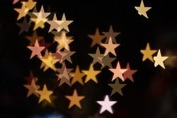 It is Star bokeh lights on black background.