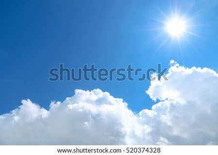 it is sun shines on blue sky and white cloud. #520374328