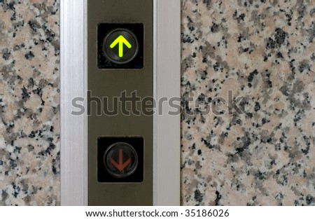 It is the elevator button of up sign.
