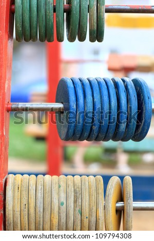 It is wooden abacus at the outdoor playground