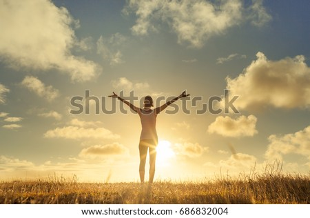 It's a beautiful life. Happy people lifestyle. Young woman in a nature setting with her arms in the air feeling free and energized.  Stock photo ©
