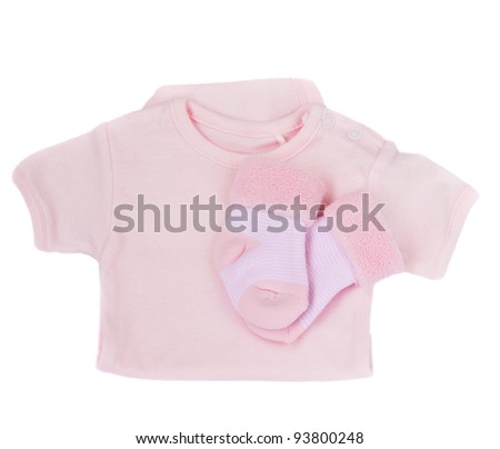 it's a girl  - baby clothes isolated on white