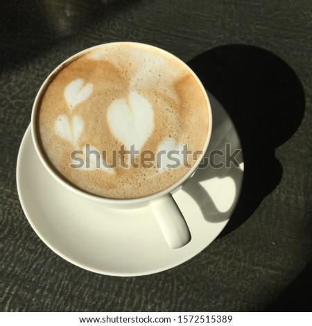 It's a hot latte with a latte art. #1572515389