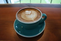It's cafe latte art.  Pretty coffee cups and beautiful latte art are lovely.